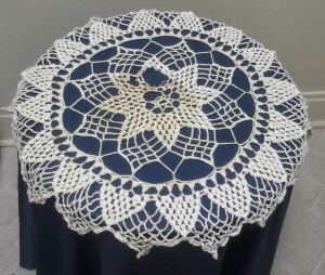My First Doily. The discoloration and hole are from water damage from having it under a plant for a few years.